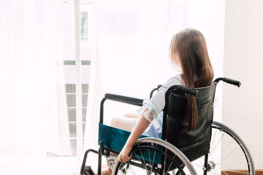 Kind im Rollstuhl,Kindim Rollstuhl